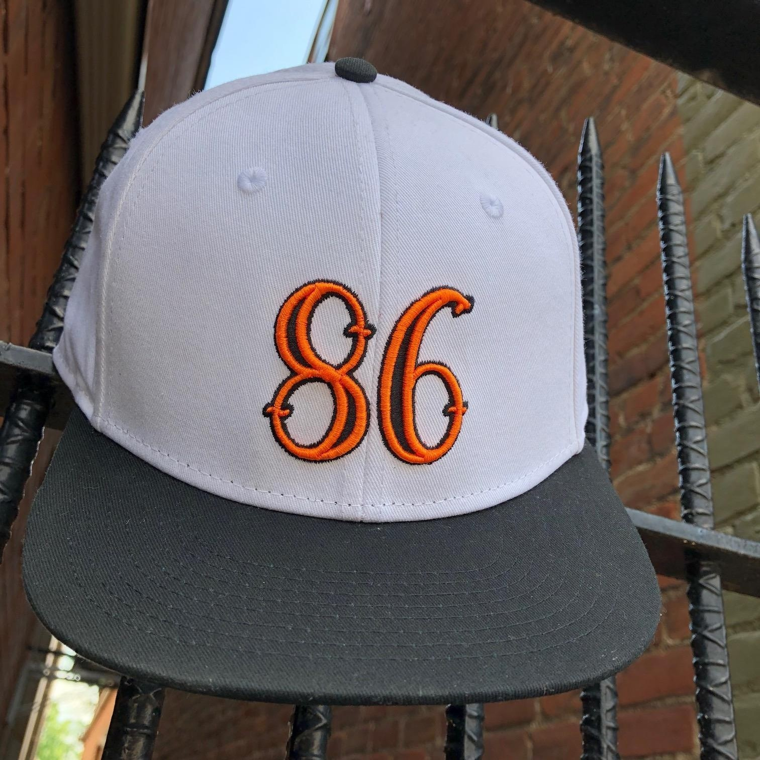 86 SNAPBACK (WHITE/BLACK/ORANGE)